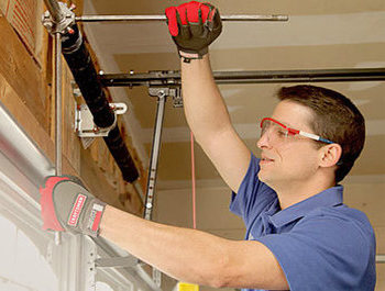 Garage Door Spring Repair The Woodlands TX